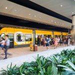 Passengers using tram at University Hospital station