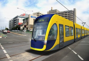 A computer-generated mock up of a G:link tram crossing the intersection of Nerang St and High St with the old Gold Coast Hospital building in the background